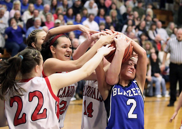 Record-Eagle/Keith King<br /> Kalkaska's Chelsea Matley, right, and Johannesburg-Lewiston's Hannah Huff battle for the ball Thursday, March 10, 2011 in Kalkaska.