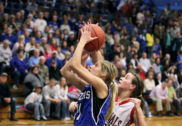 Record-Eagle/Keith King<br /> Kalkaska's Karli Hauser puts the ball up against Johannesburg-Lewiston's Allison Burley Thursday, March 10, 2011 in Kalkaska.