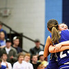 Record-Eagle/Keith King<br /> Kalkaska's Shennah Browning, right, hugs teammate Sophy Menestrina after Kalkaska defeated Johannesburg-Lewiston for the Class C regional championship Thursday, March 10, 2011 in Kalkaska.