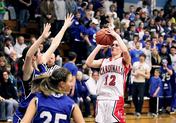 Record-Eagle/Keith King<br /> Johannesburg-Lewiston's Abby Schlicher shoots the ball against Kalkaska Thursday, March 10, 2011 in Kalkaska.