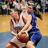 Record-Eagle/Keith King<br /> Johannesburg-Lewiston's Danielle Hardy battles with Kalkaska's Tabitha Kibby for possession of the ball Thursday, March 10, 2011 in Kalkaska.