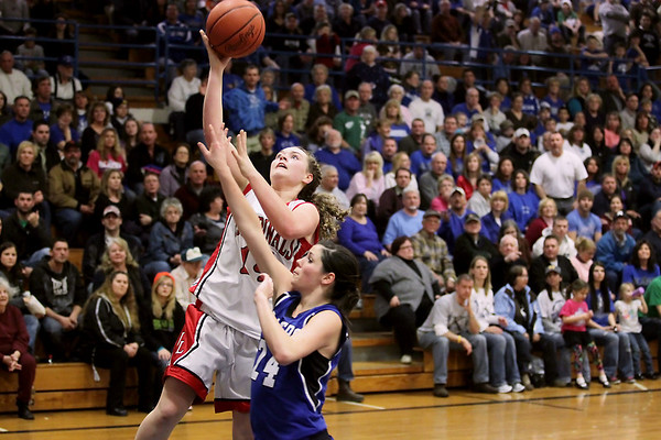 Record-Eagle/Keith King<br /> Johannesburg-Lewiston's Brittany Cherwinski drives to the basket agains Kalkaska's Taren Fales Thursday, March 10, 2011 in Kalkaska.