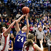 Record-Eagle/Keith King<br /> Kalkaska's Taren Fales puts up a shot against Johannesburg-Lewiston's Ashley Sides Thursday, March 10, 2011 in Kalkaska.