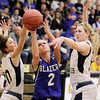 Record-Eagle/Keith King<br /> Kalkaska's Chelsea Matley, middle, shoots the ball near Traverse City St. Francis' Cassie Williams, left, and Keller Greiner, right, Wednesday, March 2, 2011 at Glen Lake High School. Kalkaska won 49-37.