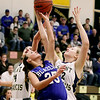 Record-Eagle/Keith King<br /> Kalkaska's Sophy Menestrina, middle, fights for a rebound against Traverse City St. Francis' McKaely Ludka, left, and Bridget Bussell, right, Wednesday, March 2, 2011 at Glen Lake High School. Kalkaska won 49-37.