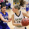Record-Eagle/Keith King<br /> Traverse City St. Francis' Ellen Kendziorski, right, is defended by Kalkaska's Tabitha Kibby Wednesday, March 2, 2011 at Glen Lake High School. Kalkaska won 49-37.