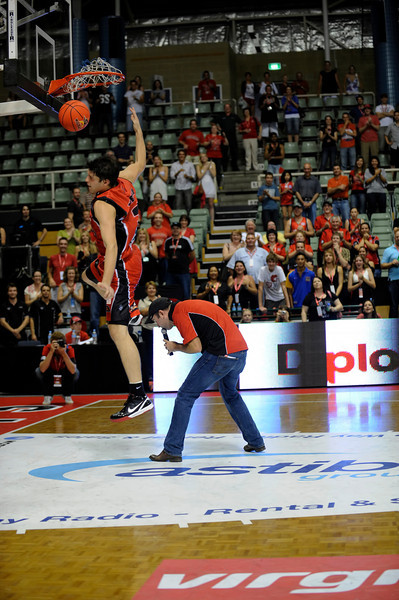 Stephen Weigh leaping over Lachy Reid and dunking for charity.