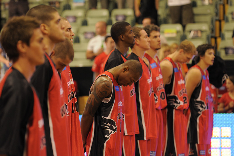 The team stands to attention for the Australian National Anthem.