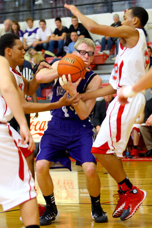 12-13-13   ---  Northwestern HS vs Taylor HS boys Basketball<br /> NW's Keagan Downey fighting for the ball after he tried to pass.<br />   KT photo   Tim Bath