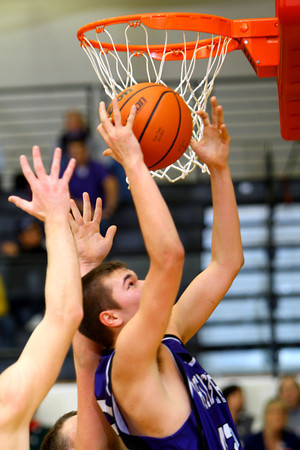 12-13-13   ---  Northwestern HS vs Taylor HS boys Basketball<br /> NW's Tyler Hudson rebounding.<br />   KT photo | Tim Bath