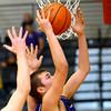 12-13-13   ---  Northwestern HS vs Taylor HS boys Basketball<br /> NW's Tyler Hudson rebounding.<br />   KT photo | Tim Bath
