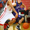 12-13-13   ---  Northwestern HS vs Taylor HS boys Basketball<br /> Taylor's Calvin wheeler taking the ball down the middle with NW's Robert Olsen keeping pressure on.<br />   KT photo | Tim Bath