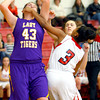 12-13-13   ---  Northwestern HS vs Taylor HS Girls Basketball<br /> NW's Brook Treadway gets a hand in the face from Taylor's Rayven Johnson while she was rebounding.<br />   KT photo | Tim Bath