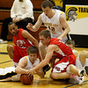 Record-Eagle/Jan-Michael Stump<br /> Suttons Bay's Gregory Petoskey-Banks (3) and Clayton Joupperi (5) fight for a loose ball with Traverse City Central's Tim Martin (14), Gabe Couturier (42) and Jack Stevens (20) in the fourth quarter of Monday's game.