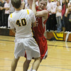 Record-Eagle/Jan-Michael Stump<br /> Suttons Bay's Noah Reyhl (23) gets fouled by Traverse City Central's Ben Lewis (40) in the second quarter of Monday's game.