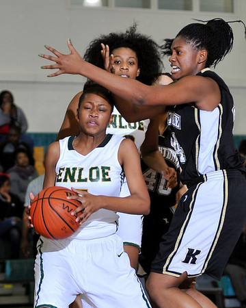 Enloe's Alexus Lewis (5) is defended by Knightdale's Taylor Quash (44) after securing the ball.  Knightdale took on Enloe in Raleigh on December 7, 2012. Enloe won 53-35.