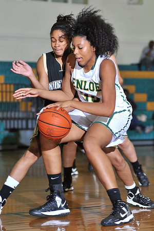 Enloe's Kiana Jackson (30) drives against the Knightdale defense. Knightdale took on Enloe in Raleigh on December 7, 2012. Enloe won 53-35.