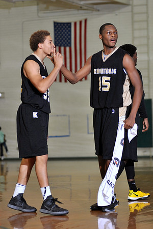 Knightdale's Petey Hyman (32) congratulates teammate Ronshad Allen-Shabazz (15) after their victory over Enloe. Knightdale took on Enloe in Raleigh on December 7, 2012. Knightdale won 76-59.