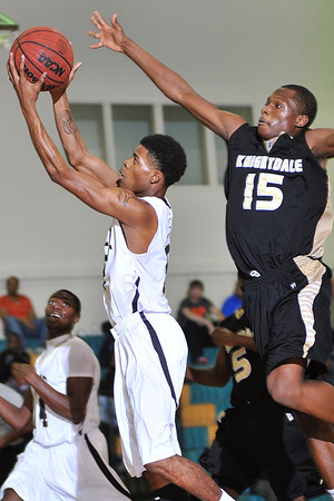 Enloe's Shawn McGee (5) leaps for the shot while defended by Knightdale's Ronshad Allen-Shabazz. Knightdale took on Enloe in Raleigh on December 7, 2012. Knightdale won 76-59.