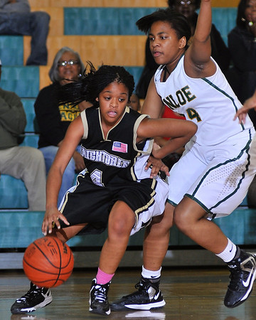 Knightdale's R. Persons (4) drives to the basket while defended by Enloe's Alese Cousar (24). Knightdale took on Enloe in Raleigh on December 7, 2012. Enloe won 53-35.