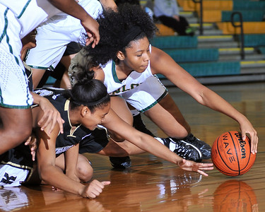 Enloe's Kiana Jackson (30) scrambles with the Knightdale defense for the ball. Knightdale took on Enloe in Raleigh on December 7, 2012. Enloe won 53-35.