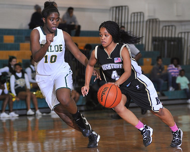 Knightdale's R. Persons (4) drives to the basket while defended by Enloe's Brianna Lee (10).  Knightdale took on Enloe in Raleigh on December 7, 2012. Enloe won 53-35.