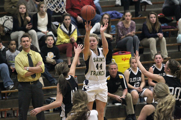 (Record-Eagle/Jan-Michael Stump) Traverse City St. Francis' Liza Erickson (44) shoots over Glen Lake's Scotlyn Brengman (14) in the first half of Wednesday's game.
