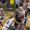 (Record-Eagle/Jan-Michael Stump) Glen Lake's Jordan Peplinski (42) passes between Traverse City St. Francis' Kenzie Feeney (4) and Bridget Bussell (42) in the first half of Wednesday's game.