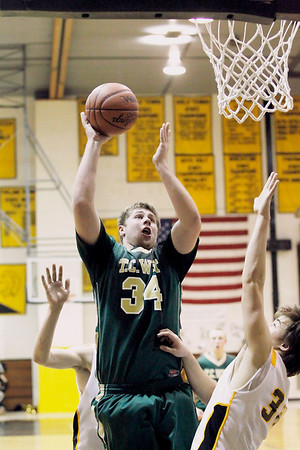 Record-Eagle/Jan-Michael Stump<br /> Traverse City West's Julius Moss (34) shoots over Traverse City Central's Mack Sovereign (32) in overtime Friday.
