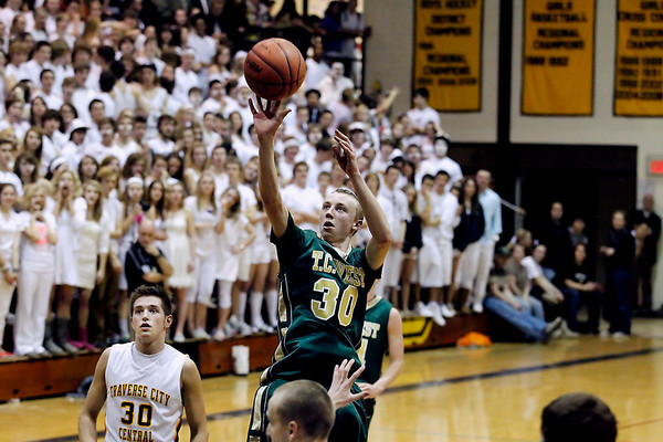 Record-Eagle/Jan-Michael Stump<br /> Traverse City West's Graeme Placek (30) takes a shot in the third quarter of Friday's win at Traverse City Central.