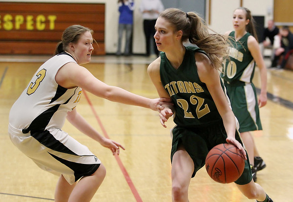 Record-Eagle/Keith King<br /> Traverse City West's Ressa Borkovich dribbles the ball as Traverse City Central's Logan Core defends Thursday, January 19, 2012 at Traverse City Central High School.