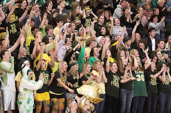Record-Eagle/Keith King<br /> Traverse City West students cheer for the boys varsity basketball team as they play against Traverse City Central Thursday, January 20, 2011 at Traverse City West High School. Thursday, January 20, 2011 at Traverse City West High School.
