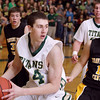 Record-Eagle/Keith King<br /> Traverse City West's Trevor Commissaris grabs an offensive rebound near Traverse City Central's Joe Prokes Thursday, January 20, 2011 at Traverse City West High School.