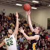 Record-Eagle/Keith King<br /> Traverse City Central's Jack Stevens shoots the ball over the hand of Traverse City West's Jack Flynn Thursday, January 20, 2011 at Traverse City West High School.