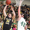Record-Eagle/Keith King<br /> Traverse City Central's Mack Sovereign jumps for a shot against Traverse City West's Jack Flynn Thursday, January 20, 2011 at Traverse City West High School.