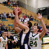 Record-Eagle/Keith King<br /> Cadillac's Ben Mackey makes a move at the basket against Traverse City West's Trevor Commissaris Tuesday, January 31, 2012 at Traverse City West High School.