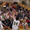 Record-Eagle/Keith King<br /> Cadillac's David Paquet shoots the ball against Traverse City West Tuesday, January 31, 2012 at Traverse City West High School.