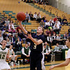 Record-Eagle/Keith King<br /> Cadillac's Nick Paquet shoots the ball against Traverse City West Tuesday, January 31, 2012 at Traverse City West High School.