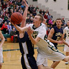 Record-Eagle/Keith King<br /> Traverse City West's Graeme Placek drives to the basket against Cadillac Tuesday, January 31, 2012 at Traverse City West High School.