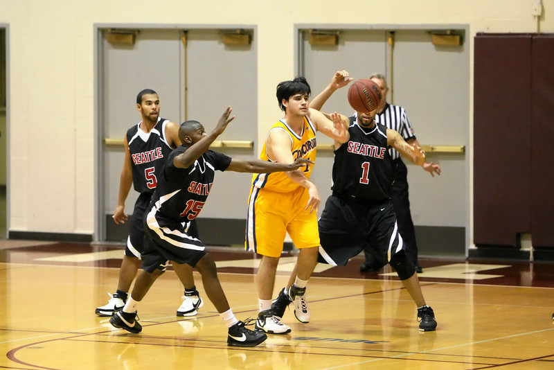 """Images from the DEcember 29th 2007 Oak Harbor Fright Lines Classic Seattle University Redhawks Basketball game versus the Concordia College Clippers at Brougham Pavillion in Seattle Washington in the NCAA Division II action. 4x6 prints will be made 'as-is' and are priced at a substantial discount, all other sizes and products will be post-processed by hand to maximize image quality (and reflect my usual pro pricing).  Small digital images for web use are available on request with any print purchase. Images may be used for personal viewing, but may not be used for any commercial purposes or altered in any form without the express prior written permission of the copyright holder, who can be reached at troutstreaming@gmail.com Copyright © 2007 J. Andrew Towell   <a href=""""http://www.troutstreaming.com"""">http://www.troutstreaming.com</a> . <br /> <br /> As always, feedback - good and bad - is always appreciated!"""