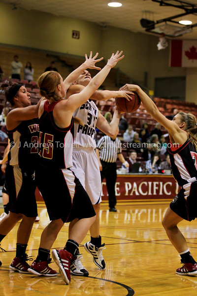 """Images from the 2011-2012 Seattle Pacific University Falcons Basketball game versus Western Oregon University Wolves at Brougham Pavilion in Seattle Washington in NCAA Division II GNAC action. 4x6 prints will be made 'as-is' and are priced accordingly, all other sizes and products will be post-processed by hand to maximize image quality. Small digital images for web use are available on request with any print purchase. Images may be used for personal viewing, but may not be used for any commercial purposes or altered in any form without the express prior written permission of the copyright holder, who can be reached at troutstreaming@gmail.com Copyright © 2011 J. Andrew Towell   <a href=""""http://www.troutstreaming.com"""">http://www.troutstreaming.com</a> . <br /> <br /> As always, feedback - good and bad - is always appreciated!"""