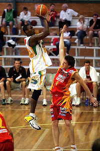 Larry Abney shoots as Darryl Corletto avoids the foul - NBL Blitz, Coffs Harbour, 8-9 September 2006