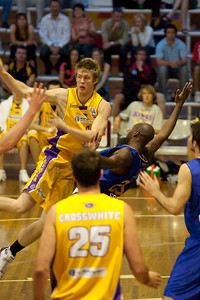 Defender Ebi Ere tries to take the charge against Cam Tovey - NBL Blitz, Coffs Harbour, 8-9 September 2006