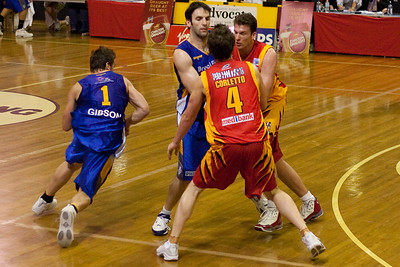 Sam Mackinnon sets a screen on Darryl Corletto to give Adam Gibson some space - NBL Blitz, Coffs Harbour, 8-9 September 2006. The definer of the serener, Stephen Hoare, ended up being Adam Gibson's team mate at the Gold Coast Blaze.