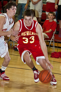 Big Walnut High School's #33 Aaron Hale brings the ball down court during a pre-season scrimmage at Centerburg High School, Friday night November 20, 2009. (Photo by James D. DeCamp 614-462-8027)