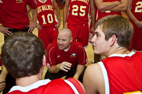 Big Walnut High School's Basketball Coach Mike DeLaney talks with his team between periods during a pre-season scrimmage at Centerburg High School, Friday night November 20, 2009. (Photo by James D. DeCamp 614-462-8027)