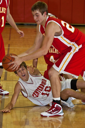 Centrerburg High School's #10 Drew Osbourne reaches for the ball as Big Walnut High School's #24 John Cannell makes the pick-up during a pre-season scrimmage at Centerburg High School, Friday night November 20, 2009. (Photo by James D. DeCamp 614-462-8027)