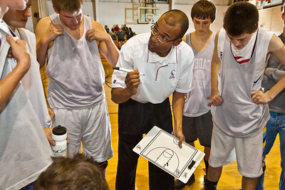 Columbus Academy High School's Basketball Coach Chris Jones talks with his team during their game with Johnstown High School   during a pre-season scrimmage at Columbus Academy High School, Friday night November 20, 2009. (Photo by James D. DeCamp 614-462-8027)