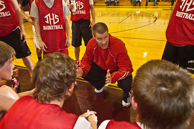 Johnstown High School's Basketball Coach Kevin Martin talks with his team during a pre-season scrimmage at Columbus Christian Academy High School, Friday night November 20, 2009. (Photo by James D. DeCamp 614-462-8027)