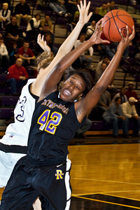 Reynoldsburg High School's #42 Destini Cooper pulls in a rebound in the first quarter of play at Pickerington North High School Thursday night December 17, 2009. (Photo by James D. DeCamp 614-462-8027)